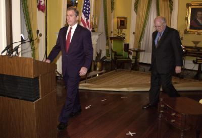 Photo of Dubya  and the dotted line pointing to the big podium he has to walk up to
